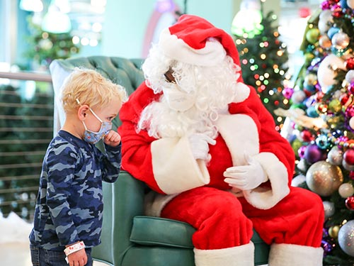Young boy visiting Santa