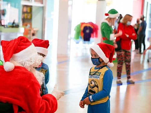 Kids meeting with Santa at the Mississippi Children's Museum