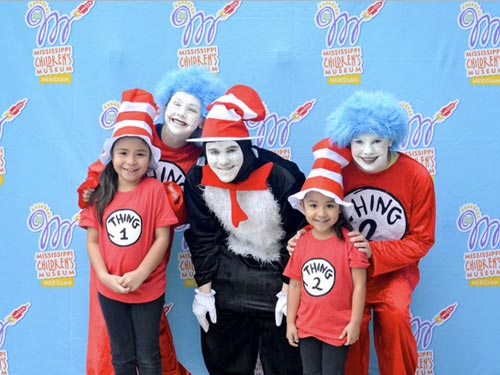 5 People Posing with Dr. Seuss