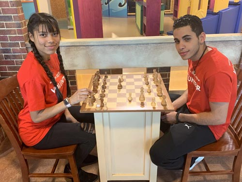 2 People Playing Chess