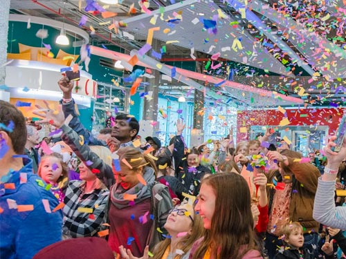 People Celebrating in Confetti