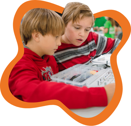 Two boys working on a science project