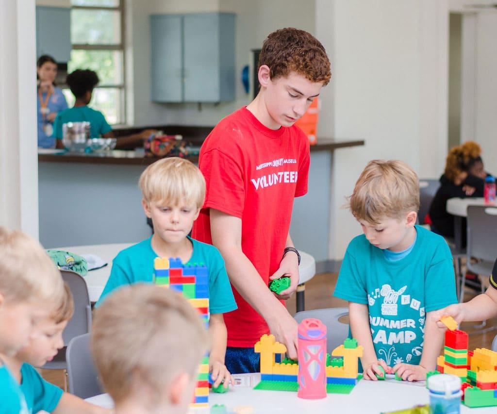 MCM Volunteers working with kids