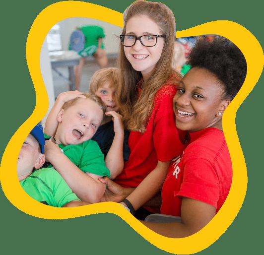 MCM Volunteers and kids smiling