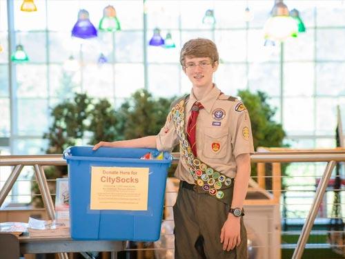 Boy Scout holding box