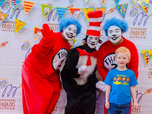 Thing 1 & Thing 2 posting with kid and Dr. Seuss