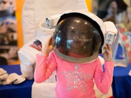 Girl with astronaut helmet