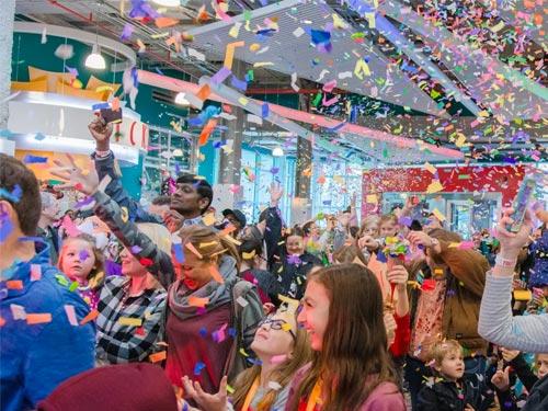 People celebrating confetti